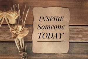 "Sign saying ""Inspire Someone Today"""
