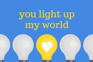 "Lightbulbs with heart graphics at the center, and text: ""you light up my world"""