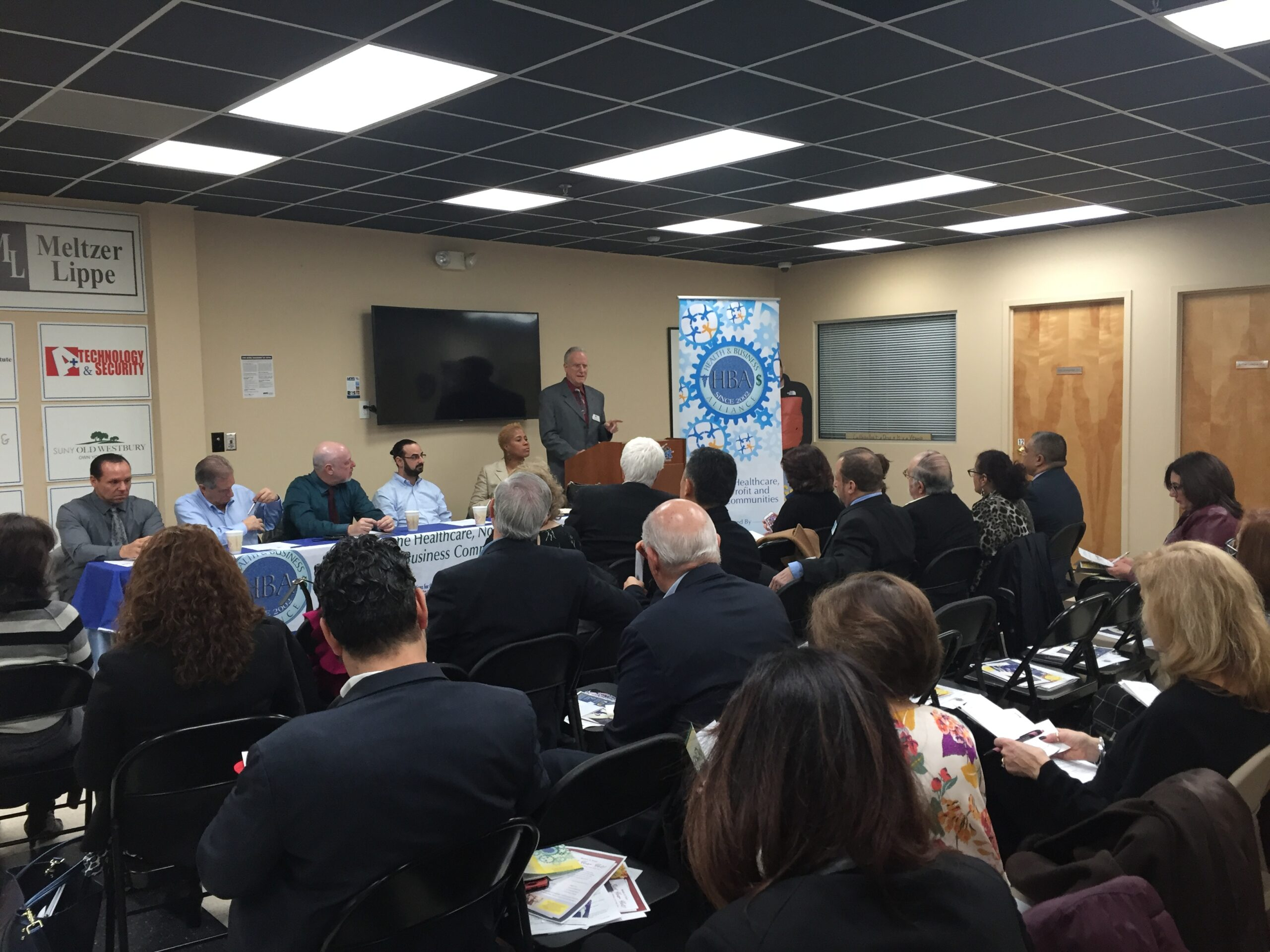 David B. Alexander speaking at a Health & Business Alliance meeting