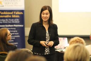 Female motivational speaker, smiling